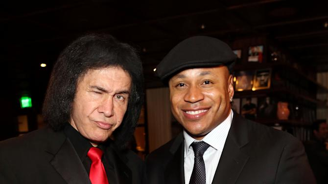 Gene Simmons, left, and LL Cool J attend Hennessy Black: A Dinner with LL Cool J and Mark Burnett Celebrating Music's Biggest Night Out, on Sat., Feb., 9, 2013 in Los Angeles. (Photo by Casey Rodgers/Invision for Hennessy/AP Images)