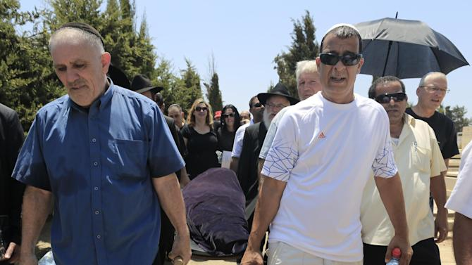 FILE - In this July 20, 2012 file photo, relatives carry the body Kochava Shriki, 44, in Rishon Lezion, Israel, two days after she was killed in a suicide bombing in Bulgaria. Officials have blamed the attack on Hezbollah. Iran's elite Quds Force and Hezbollah militants are learning from a series of botched terror attacks over the past two years and pose a growing threat to the U.S. and other Western targets as well as Israel, a prominent counterterrorism expert says. The terror plot in Bulgaria suggests that militants may be learning from their missteps. (AP Photo/Tsafrir Abayov, file)