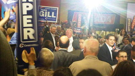 Conservative Leader Stephen Harper and Toronto Mayor Rob Ford shake hands during a rally in Brampton, Ont., on Friday night.