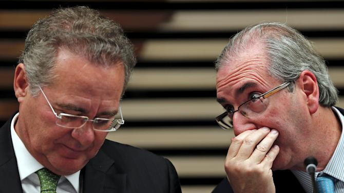 "resident of the Chamber of Deputies Eduardo Cunha talks with Brazilian Senator Renan Calheiros during the event ""More Women in Politics"" in Sao Paulo"