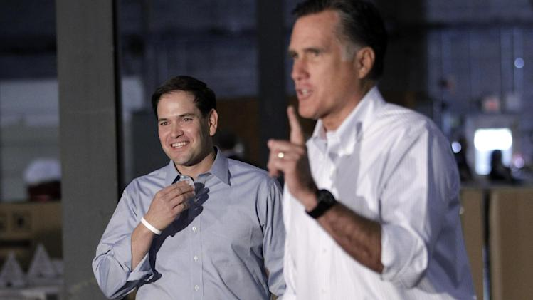 Sen. Marco Rubio, R-Fla. smiles at left as he joins Republican presidential candidate, former Massachusetts Gov. Mitt Romney for a news conference prior to a town hall-style meeting in Aston, Pa., Monday, April 23, 2012. (AP Photo/Jae C. Hong)