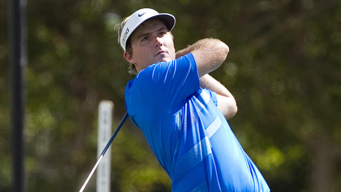 Russell Henley drives off the first tee during the third round of the Sony Open golf tournament, Saturday, Jan. 12, 2013, in Honolulu.  (AP Photo/Marco Garcia)