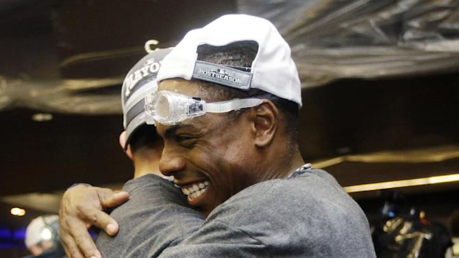 New York Yankees' Curtis Granderson embraces a teammate as they celebrate their 14-2 win over the Boston Red Sox in their baseball game at Yankee Stadium in New York, Wednesday, Oct. 3, 2012. The Yankees clinched the American League East title. (AP Photo/Kathy Willens)