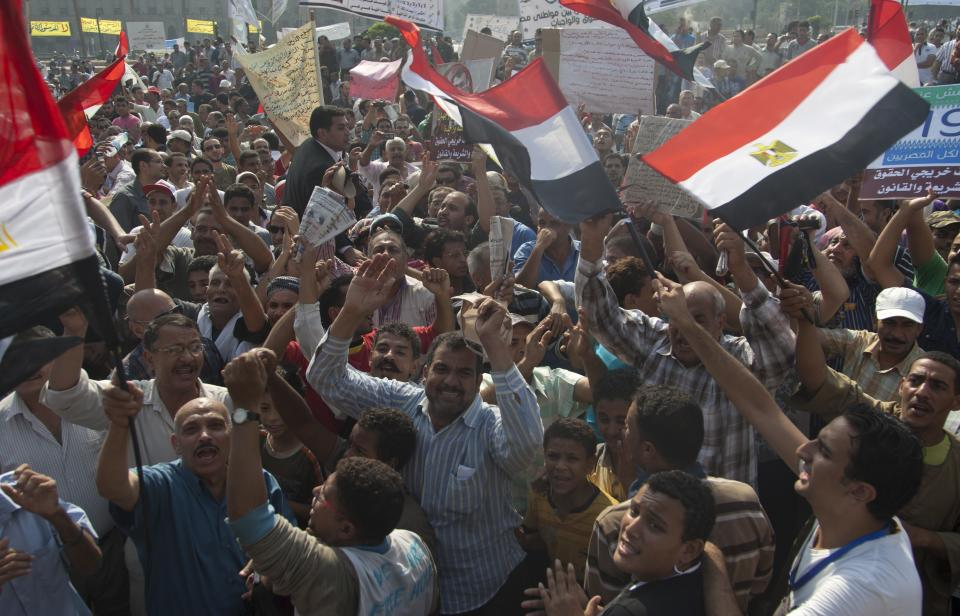 Protesters chant anti-government slogans during a rally in Tahrir Square in Cairo, Egypt, Friday, Oct. 19, 2012. Several thousand Egyptian protesters are rallying in Cairo to demand the president and his Muslim Brotherhood supporters ensure the country's constitution represents all factions of society. (AP Photo/Khalil Hamra)