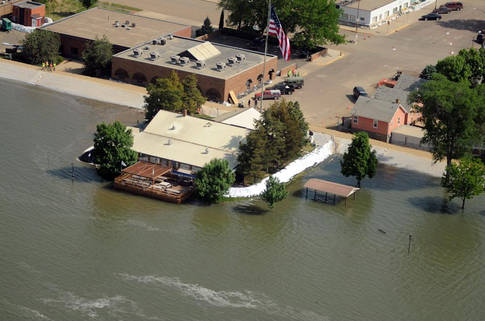 The Missouri River surrounds the American Legion cabin at the end of Pierre Street in Pierre, S.D., on Tuesday, June 7, 2011. The Army Corps of Engineers increased releases from the Oahe Dam to 150,000 cubic feet of water per second on Tuesday. (AP Photo/Capital Journal, Chris Mangan)