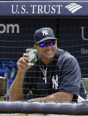 New York Yankees' Alex Rodriguez watches his team play against the Detroit Tigers during the first inning of a baseball game Saturday, Aug. 10, 2013, in New York. (AP Photo/Frank Franklin II)