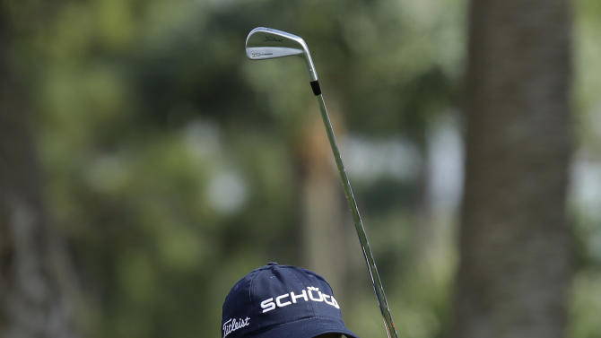 Geoff Ogilvy, from Australia, watches his shot from the seventh tee during the third round of the Honda Classic golf tournament in Palm Beach Gardens, Fla., Saturday, March 2, 2013. (AP Photo/J Pat Carter)