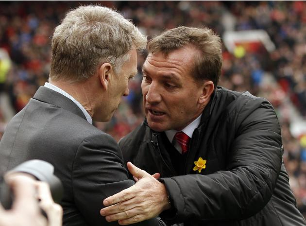 Manchester United's manager Moyes greets his Liverpool counterpart Rodgers before their English Premier League soccer match in Manchester