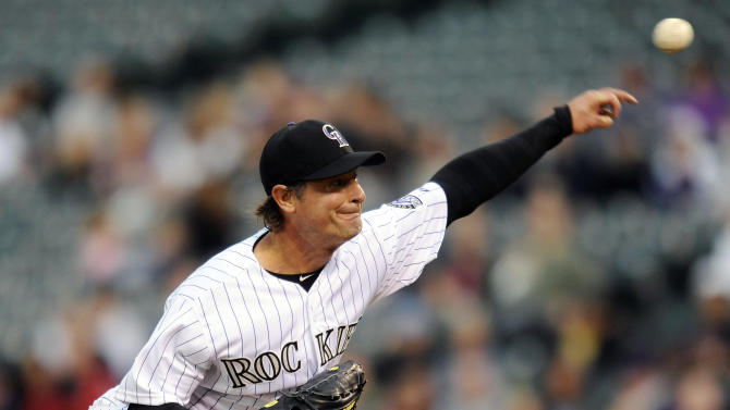 Colorado Rockies starting pitcher Jamie Moyer throws in the first inning of a baseball game against the San Diego Padres on Tuesday, April 17, 2012, in Denver. (AP Photo/Chris Schneider)