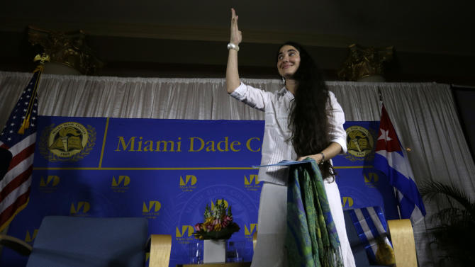 Blogger and activist Yoani Sanchez, of Cuba, waves after speaking at the Freedom Tower of Miami Dade College, Monday, April 1, 2013, in Miami. Sanchez has gained thousands of followers worldwide for her candid descriptions of modern life in Cuba on her blog Generation Y. (AP Photo/Lynne Sladky)