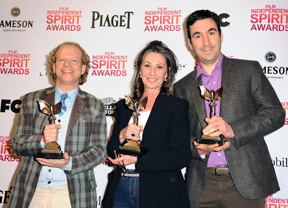 "Producers Bruce Cohen, left, Donna Gigliotti, and Jonathan Gordon, right, pose backstage with the award for best feature for ""Silver Linings Playbook"" at the Independent Spirit Awards on Saturday, Feb. 23, 2013, in Santa Monica, Calif.  (Photo by Jordan Strauss/Invision/AP)"