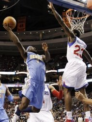 Denver Nuggets' Ty Lawson (3) goes up for a shot as Philadelphia 76ers' Lou Williams (23) defends in the first half of an NBA basketball game, Wednesday, Jan. 18, 2012, in Philadelphia. (AP Photo/Matt Slocum)