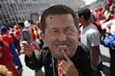 A supporter of Venezuela's President Hugo Chavez wears a mask depicting him during a rally in Caracas