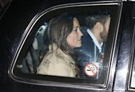 Pippa Middleton and her brother James (R) leave after visiting their sister Catherine, Duchess of Cambridge at the King Edward VII hospital in London December 5, 2012. REUTERS/Olivia Harris/Files