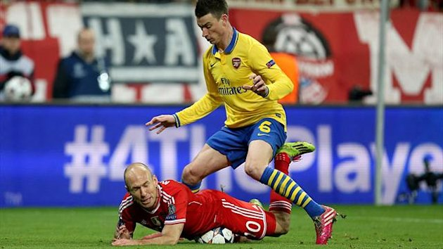 Arsenal's Laurent Koscielny (right) fouls Bayern Munich's Arjen Robben in the penalty area (PA Photos)