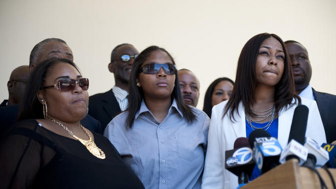 Rodney King's daughters, from left, Candice King, Tristian King, and Laura Dene King speak before a public memorial service for their father at Forest Lawn-Hollywood Hills, Los Angeles, Saturday, June 30, 2012. King passed away earlier this month at 47. (AP Photo/Grant Hindsley)