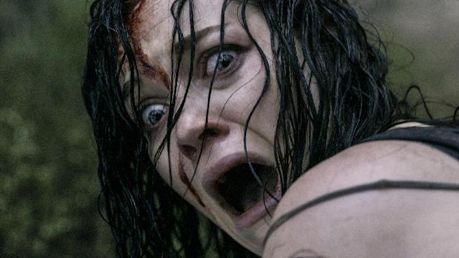 """This film image released by Sony-TriStar Pictures shows Jane Levy in a scene from """"Evil Dead."""" (AP Photo/Sony-TriStar Pictures)"""