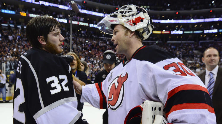 Los Angeles Kings goalie Jonathan Quick, left, is congratulated byg New Jersey Devils goalie Martin Brodeur after the Kings defeated the Devils 6-1 to win the Stanley Cup during Game 6 of the NHL hockey Stanley Cup finals, Monday, June 11, 2012, in Los Angeles. (AP Photo/Mark J. Terrill)