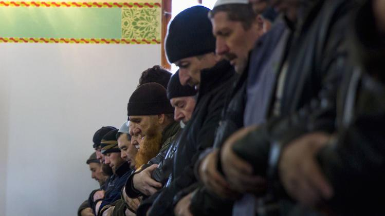 Crimean Tatars pray in the Khan Chair mosque in Bakhchisaray, near Simferopol