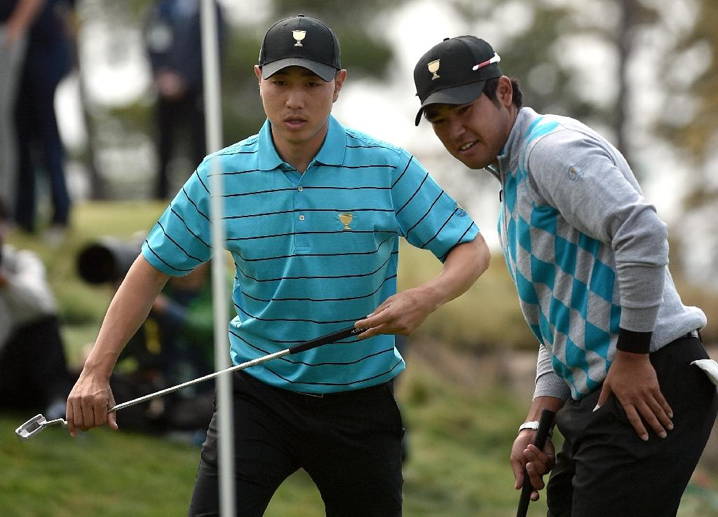 Bae, Matsuyama storm to victory as cup remains on knife edge