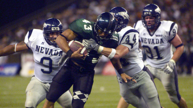 FILE - In this Oct. 9, 2004, file photo, Hawaii's Bryan Maneafaiga (43) scores a touchdown against Nevada in Honolulu. With uneven testing for steroids and inconsistent punishment, college football players are packing on significant weight _ in some cases, 30 pounds or more in a single year _ without drawing much attention from their schools or the NCAA in a sport that earns tens of billions of dollars for teams. But looking solely at the most significant weight gainers also ignores players like Maneafaiga. In the summer of 2004, Maneafaiga was an undersized 180-pound running back trying to make the University of Hawaii football team. Twice, once in pre-season and once in the fall, he failed school drug tests, showing up positive for marijuana use. What surprised him was that the same tests turned up negative for steroids. He'd started injecting stanozolol, a steroid, in the summer to help bulk up to a roster weight of 200 pounds. (AP Photo/ Honolulu Star-Advertiser, George F. Lee)