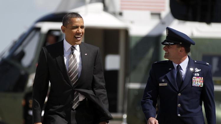 President Barack Obama walks with U.S. Air Force Col. Ken Rizer from Marine One to Board Air Force One, Tuesday, April, 24, 2012, at Andrews Air Force Base, Md., en route to North Carolina. (AP Photo/Carolyn Kaster)