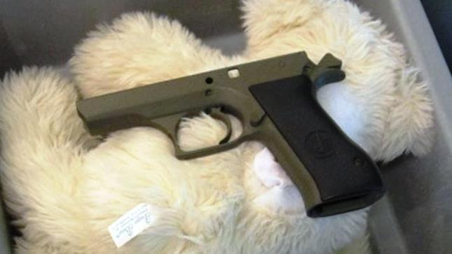 "This undated photo provided by the federal Transportation Security Administration shows pistol parts hidden in a stuffed animal found by TSA officials at T.F. Green Airport in Warwick, R.I., Monday May 7, 2012.  The TSA said Tuesday that a man traveling to Detroit with his 4-year-old son was stopped when a TSA officer noticed the disassembled gun components ""artfully concealed"" inside three stuffed animals. The stuffed animals were inside a carry-on bag that was put through an x-ray machine as part of normal security screening. (AP Photo/Transportation Security Administration)"
