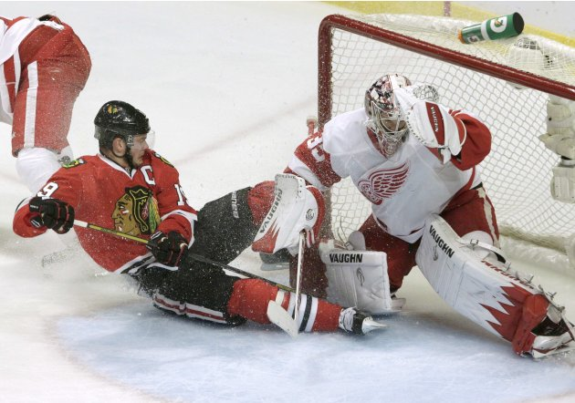 Detroit Red Wings goalie Howard makes a save on Chicago Blackhawks center Toews during Game 5 of their NHL Western Conference semifinal playoff hockey game in Chicago