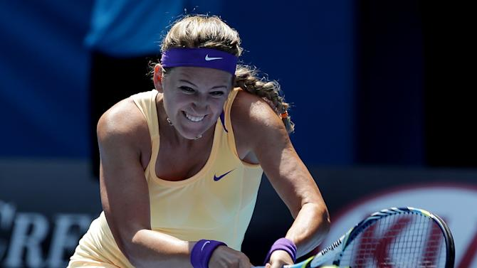 Victoria Azarenka of Belarus hits a return to Russia's Elena Vesnina during their fourth round match at the Australian Open tennis championship in Melbourne, Australia, Monday, Jan. 21, 2013.(AP Photo/Aaron Favila)