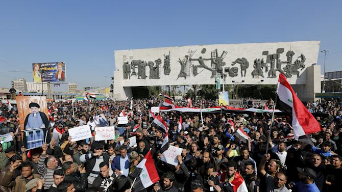 Supporters of prominent Iraqi Shi'ite cleric Moqtada al-Sadr shout slogans during a demonstration in Baghdad