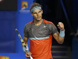 Rafael Nadal of Spain celebrates defeating Thanasi Kokkinakis of Australia during their men's singles match at the Australian Open 2014 tennis tournament in Melbourne