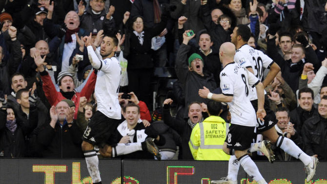 Fulham's Clint Dempsey, left, celebrates scoring against Stoke City from the penalty spot during their English Premier League soccer match at the Craven Cottage Stadium, London, Saturday, Jan. 22, 2011. (AP Photo/Tom Hevezi) NO INTERNET/MOBILE USAGE WITHOUT FOOTBALL ASSOCIATION PREMIER LEAGUE (FAPL) LICENCE. CALL +44 (0) 20 7864 9121 or EMAIL info@football-dataco.com FOR DETAILS