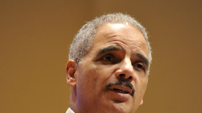 """Attorney General Eric Holder speaks at the Northwestern University law school, Monday, March 5, 2012 in Chicago. Holder said Monday that the decision to kill a U.S. citizen living abroad who poses a terrorist threat """"is among the gravest that government leaders can face,"""" but justified lethal action as legal and sometimes necessary in the war on terror. (AP Photo/Brian Kersey)"""
