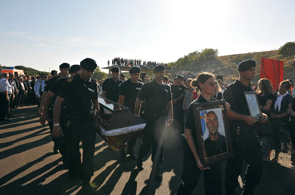 Members of Kosovo Police carry coffin of the slain officer Enver Zymberi in the village of Dubovc on Wednesday, July 27, 2011. Zymberi was killed in an ambush during a police operation to take control of two border crossings with Serbia in Kosovo's Serb-dominated north. (AP Photo/Visar Kryeziu)