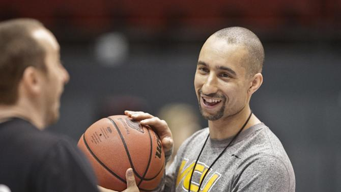 In this March 20, 2014, file photo, VCU coach Shaka Smart sports a smile during practice for the NCAA men's college basketball tournament in San Diego. Smart is loving life. He's got a nationally regarded team, perhaps its highest-ranked recruiting class and a $25 million practice facility under construction