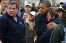 U.S. President Barack Obama hugs marina owner after it was destroyed by Hurricane Sandy in New Jersey