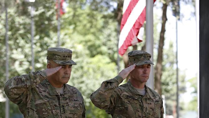U.S. General John Campbell, commander of NATO-led International Security Assistance Force (ISAF), salutes during a ceremony to commemorate Memorial Day in Kabul,