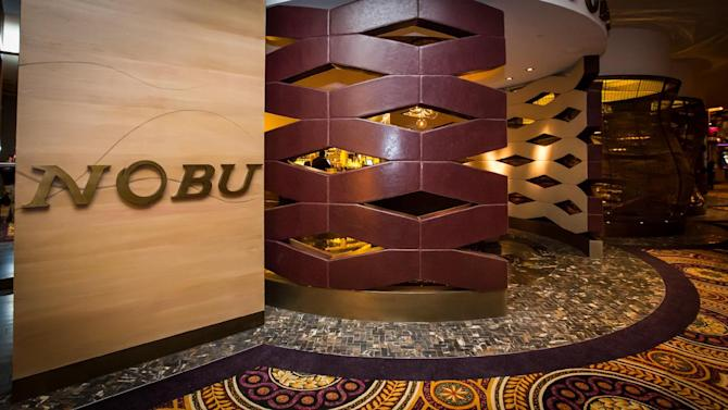 This Feb. 2, 2013 photo provided by the Nobu Hotel shows the new Nobu Hotel and Restaurant in Las Vegas. The wood-carved entry to the 181-room Nobu hotel merges into the 327-seat restaurant, now the largest Nobu in the world. (AP Photo/Nobu Hotel, Eric Kabik)