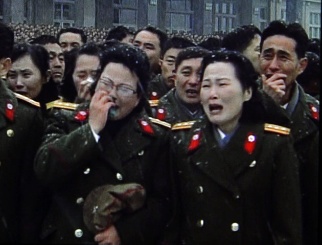 In this image made from KRT video, North Korean military personnel cry during a funeral for late North Korean leader Kim Jong Il, in snowy Pyongyang, North Korea, Wednesday, Dec. 28, 2011. (AP Photo/K