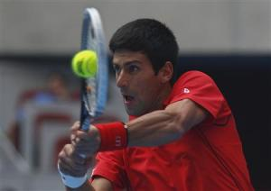 Djokovic of Serbia returns a shot during match against Verdasco of Spain at China Open tennis tournament in Beijing