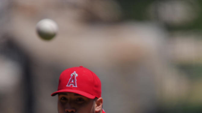 Los Angeles Angels starting pitcher Hector Santiago throws to the plate during the first inning of a baseball game against the Texas Rangers, Sunday, April 26, 2015, in Anaheim, Calif. (AP Photo/Mark J. Terrill)