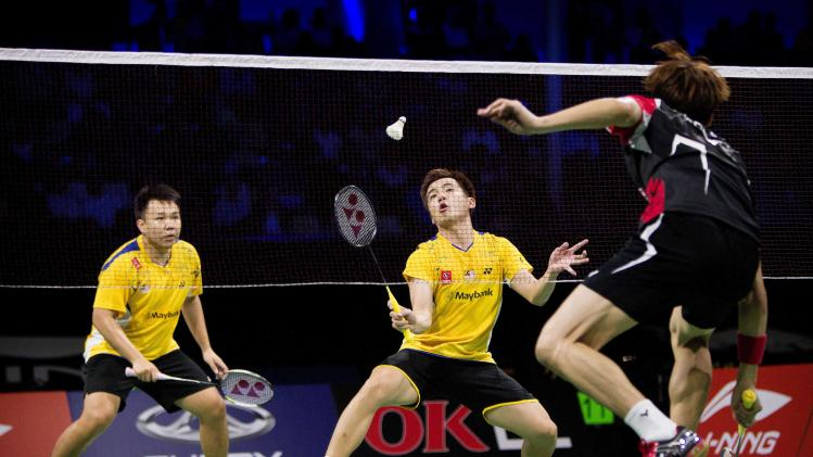 Malaysia's Hoon and Tan play against South Korea during their mens' doubles quarter-final match at the Badminton World Championships in Copenhagen