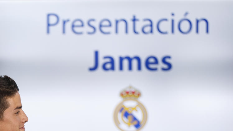 New Real Madrid player James Rodriguez, from Colombia, attends his official presentation at the Santiago Bernabeu stadium in Madrid, Spain, Tuesday, July 22, 2014, after signing for Real Madrid. Real Madrid have signed Rodriguez from Monaco on a six-year contract, (AP Photo/Daniel Ochoa de Olza)