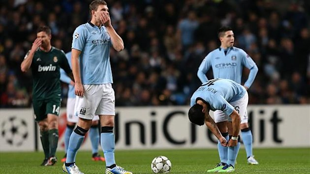 Manchester City's Edin Dzeko and Sergio Aguero stand dejected after conceding the opening goal of the game