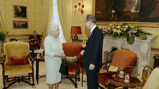 Britain's Queen Elizabeth speaks with U.N. Secretary-General Ki-moon during a reception in the San Anton Palace in Attard