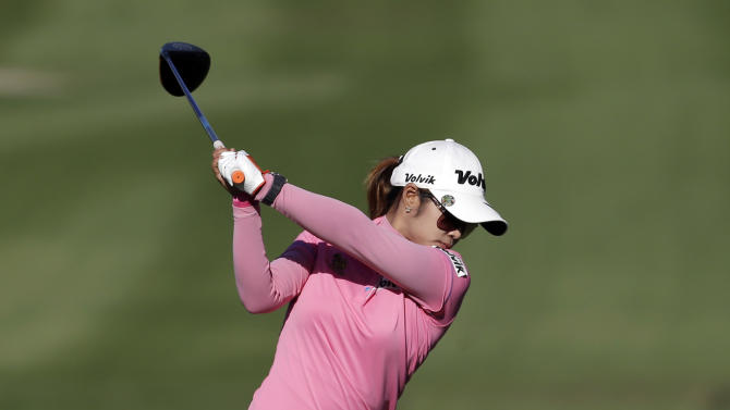Pornanong Phatlum, of Thailand, hits her tee shot on the 15th hole during the second round of the LPGA Kraft Nabisco Championship golf tournament in Rancho Mirage, Calif. Friday, April 5, 2013. (AP Photo/Chris Carlson)