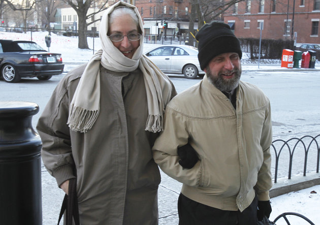Kenneth Miller, right, walks with his wife to federal court on Thursday, Jan. 24, 2013 in Burlington, Vt. Miller of Virginia, convicted of helping a woman and her daughter flee the country rather than share custody of the girl, is due to testify before a federal grand jury.(AP Photo/Toby Talbot)