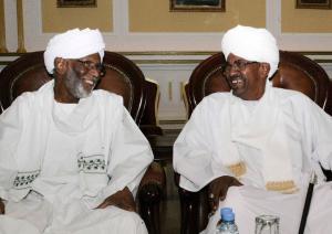 Sudan's President Omar al-Bashir (R) and al-Turabi…