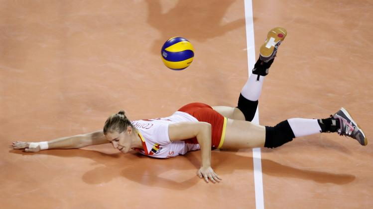 Courtois of Belgium fails to receive the ball from Russia during their FIVB Women's Volleyball World Grand Prix 2014 final round match in Tokyo