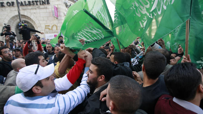 Palestinian Fatah and Hamas supporters scuffle during a march against Israel's military operations in Gaza Strip, in the West Bank city of Ramallah, Friday, Nov. 16, 2012. (AP Photo/Majdi Mohammed)